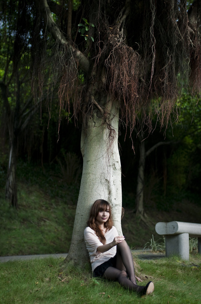 girl sitting at tree